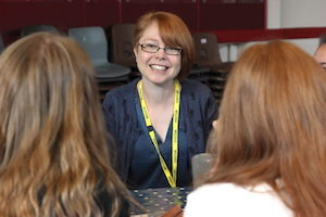 """Form the Future volunteer with Year 8 students for a """"What's My Line?"""" event"""