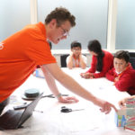 Volunteers from Mott MacDonald lead students through the activities.