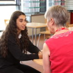 Year 10 student from NCA meeting with her mentor