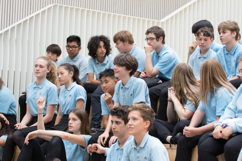 Year 9 students from Trumpington CC watching their peers' presentations