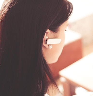 Female employee wearing telephone headset - Contact Us